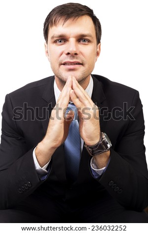 Portrait of confident young businessman looking at camera isolated on white - stock photo