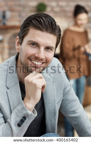 Portrait of confident young businessman smiling happy hand on chin. - stock photo