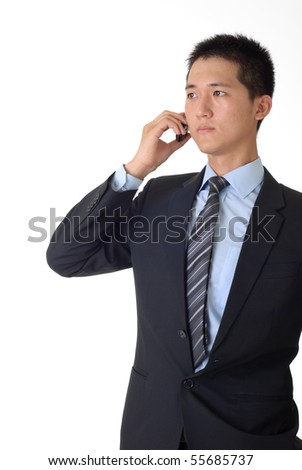 Portrait of confident young businessman talking on cellphone with copyspace. - stock photo