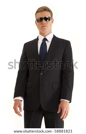 Portrait of confident young businessman wearing a suit and sunglasses