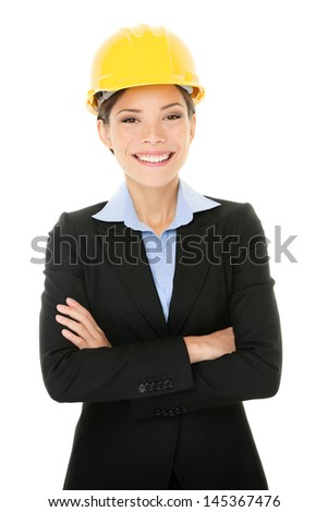 Portrait of confident young female architect standing arms crossed isolated over white background - stock photo
