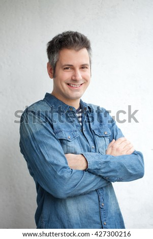 Portrait of confident young man - stock photo