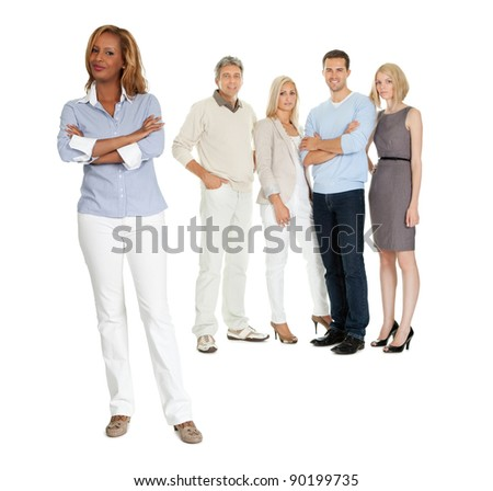 Portrait of confident young woman with her team standing in background on white - stock photo