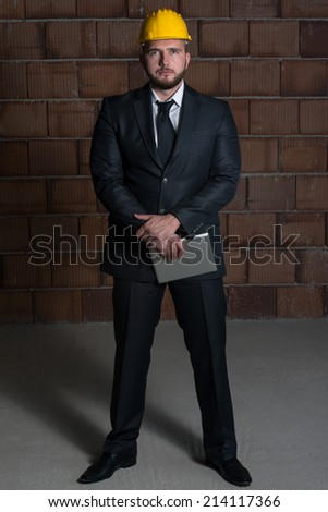 Portrait Of Construction Master With Personal Computer In Hands - stock photo