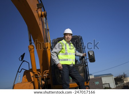 Portrait of construction worker standing on a construction site  - stock photo