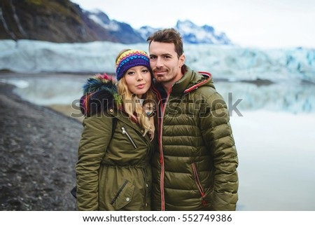 portrait of couple at lake shore and mountains