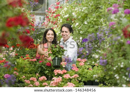 Portrait of couple at plant nursery