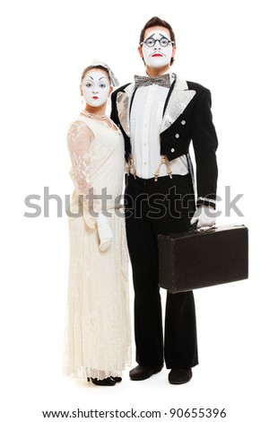 portrait of couple mimes over white background - stock photo