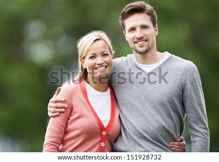 Portrait Of Couple On Countryside Walk - stock photo