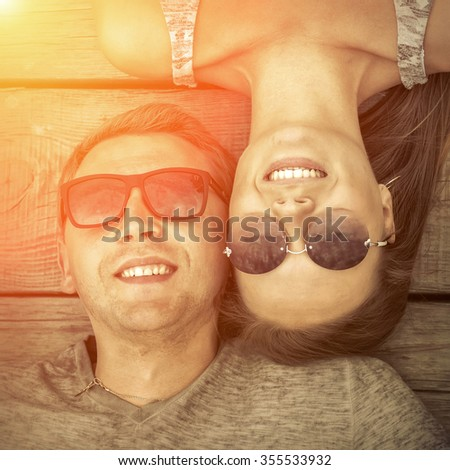 Portrait of couple on the wooden background. - stock photo