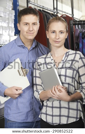 Portrait Of Couple Running On Line Fashion Business - stock photo