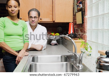 Portrait of couple standing in kitchen