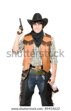 Portrait of cowboy with a gun and bottle of whiskey in hands. Isolated