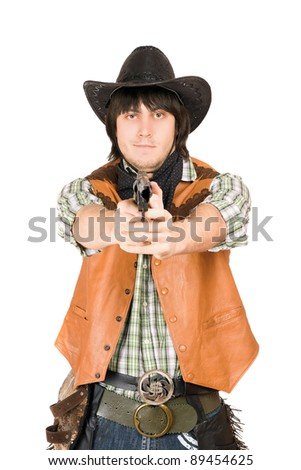 Portrait of cowboy with a gun in hands - stock photo