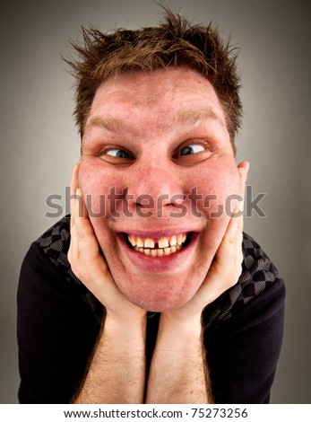 Portrait of crazy bizarre man making faces - stock photo