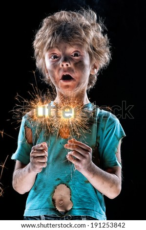 Portrait of crazy little boy over black background - stock photo