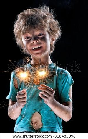 Portrait of crazy little boy over black background - stock photo