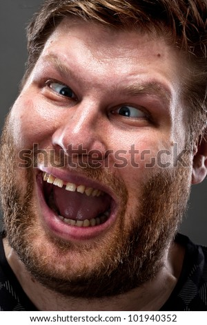 Portrait of crazy man making stupid face - stock photo