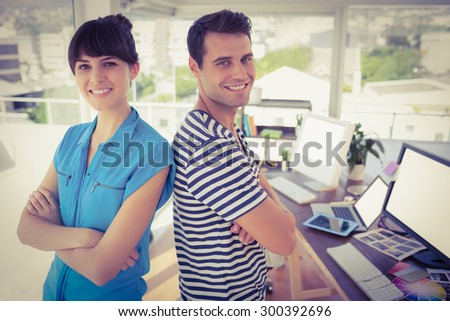 Portrait of creative young business people posing in the office - stock photo