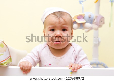 Portrait of crying baby girl. - stock photo