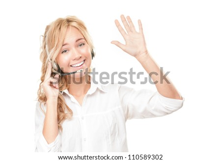 Portrait of customer service and call centre operator woman isolated on white background. Smiling girl in headset giving greeting sign with her hand, offering help and support. - stock photo
