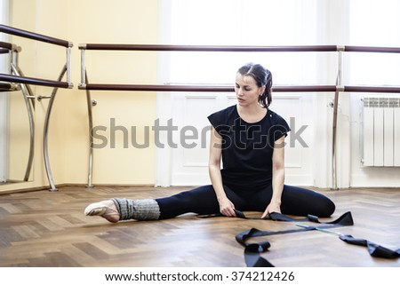 Portrait of cut Pretty rhythmic gymnast girl exercising with ribbon  - stock photo