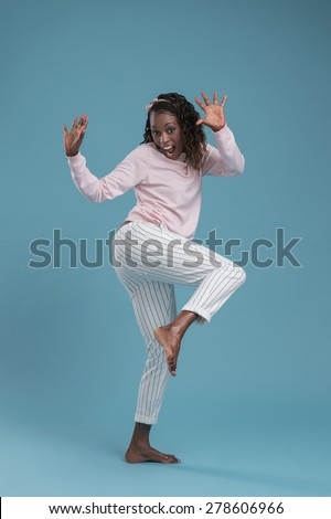 Portrait of cute african woman posing - dancing full length - stock photo