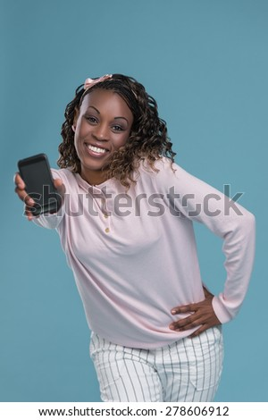 Portrait of cute african woman posing - showing smartphone to camera - stock photo