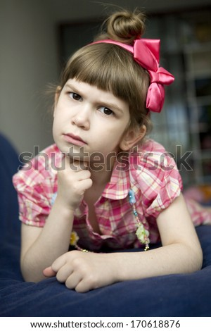 portrait of cute angry girl five year old with bow - stock photo