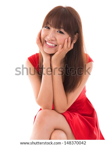 Portrait of cute Asian woman smiling wearing red dress isolated on white background. Asian female model. - stock photo