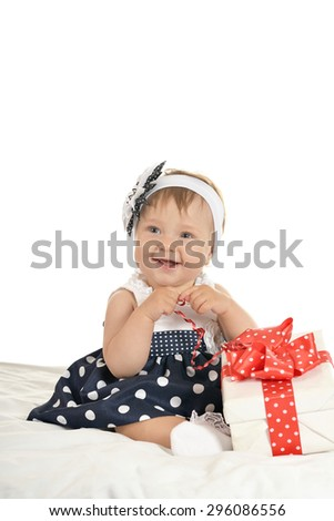Portrait of Cute baby girl with gift - stock photo