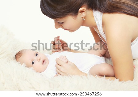 Portrait of cute baby with young mom at home, comfort