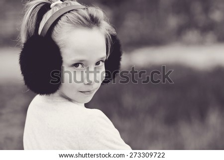 portrait of cute blonde girl outdoors in spring time - stock photo