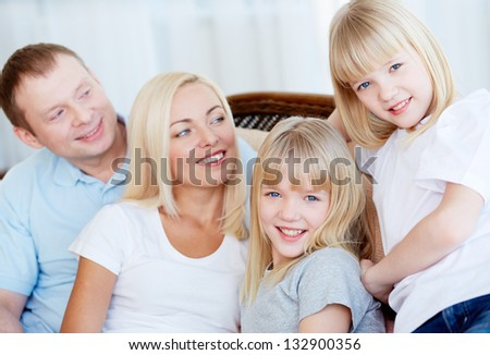 Portrait of cute blonde twins and their smiling parents