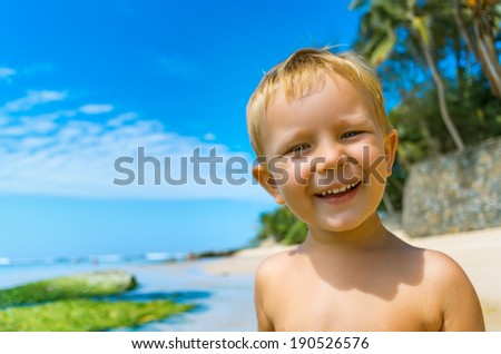 Portrait of cute boy have fun on tropical beach - stock photo