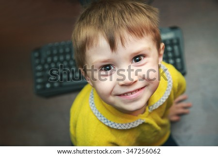 Portrait of cute boy looking at camera  - stock photo