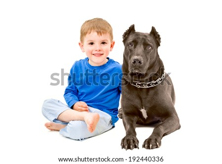 Portrait of cute boy sitting with a dog - stock photo
