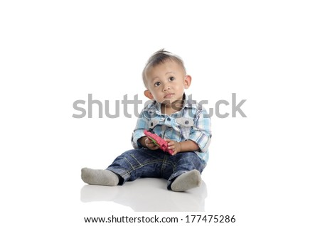 Portrait of cute cheeky toddler on the floor isolated on white - stock photo