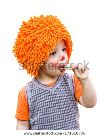 Portrait of cute clown child eating a lollipop isolated on white background - stock photo