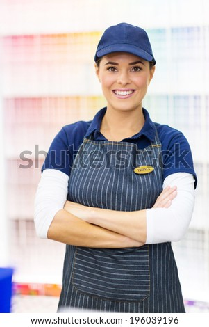 portrait of cute female paint store worker - stock photo