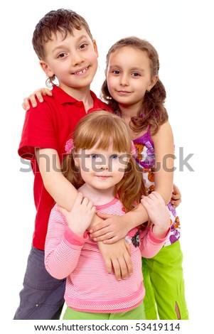 Portrait of cute girl being embraced by her friends behind - stock photo