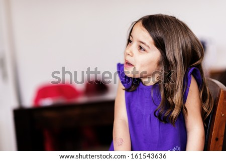 Portrait of cute girl concentrated