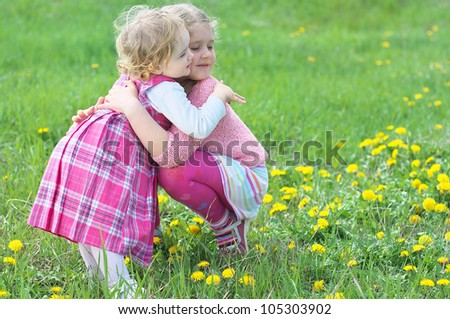 Portrait of cute girl embracing her sister - stock photo