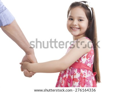 Portrait of cute girl holding father's hand against white background - stock photo