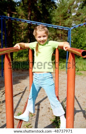 Portrait of cute girl looking at camera while playing outdoors