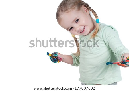 Portrait of cute girl painting with paintbrush - stock photo