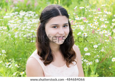Portrait of cute girl with hairstyle of long hair on the outside