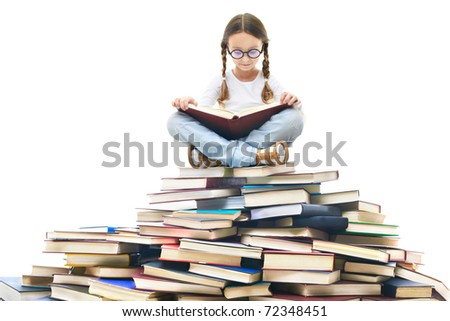 Portrait of cute girl with open book and looking at camera