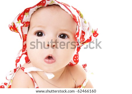 Portrait of cute grimacing baby girl in hat isolated on white background - stock photo