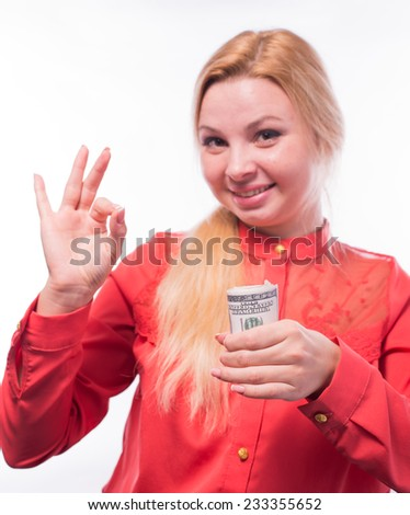 Portrait of cute happy girl holding in hand a lot american dollars, isolated on white background, spending money concept - stock photo